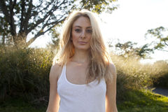 Backlit Blond in White Top Stock Photos