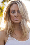 Backlit Blond in White Top Royalty Free Stock Photo