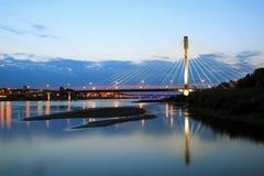 Backlit bridge at night Stock Images