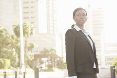 Backlit businesswoman Royalty Free Stock Photos