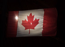 Backlit Canadian Flag in the Night Stock Photography
