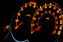 Backlit car dashboard dials glowing at night Royalty Free Stock Photo