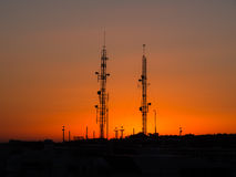 Backlit of cellular antenna tower Royalty Free Stock Image