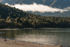 Backlit cloud above lake Rotoiti in Nelson Lakes National Park Royalty Free Stock Image