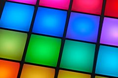 Backlit colorful buttons of a sound recording pad. Close up view of backlit colorful buttons of a sound recording pad stock photos