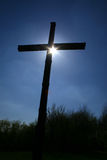 Backlit cross. A cross with the sun behind it Stock Images