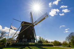 Backlit dutch mill Royalty Free Stock Images