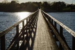 Backlit footbridge Stock Photos