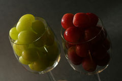Backlit grapes in the glass Stock Image