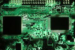 Backlit green printed circuit board - PCB texture Royalty Free Stock Photo