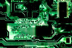 Backlit green printed circuit board - PCB texture. Macro picture of backlit printed circuit board with chips Royalty Free Stock Images