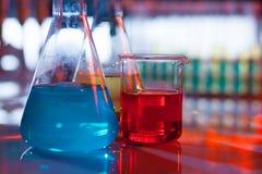 Backlit laboratory flask. Stock Photography