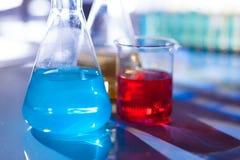 Backlit laboratory flask. Royalty Free Stock Image