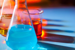 Backlit laboratory flask. Stock Photo