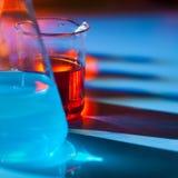 Backlit laboratory flask. Royalty Free Stock Photos