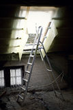 Backlit ladder in the attic Stock Photography