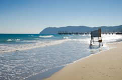 Backlit Lifeguard Chair on Alassio Beach royalty free stock image