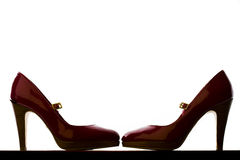 Backlit Pair of Red High Heels Stock Photo