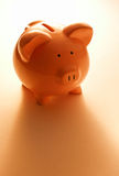 Backlit pink piggy bank Stock Photography