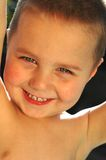 Backlit portrait of a child. Excited, smiling little boy with an angelic, pure complexion Stock Photos
