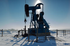 Backlit Pump Jack, Alberta Canada Royalty Free Stock Images
