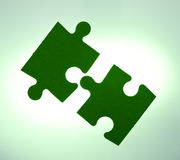 Backlit puzzle pieces - solution concept Stock Photography