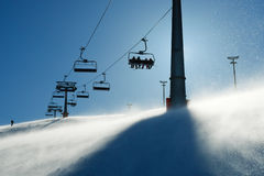 Backlit scenes with ski lift chairs Royalty Free Stock Photography