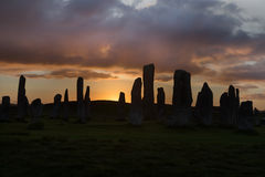 Backlit standing stones Royalty Free Stock Photos