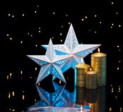 Backlit stars in blue with golden candles Stock Image