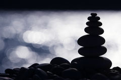 Backlit Stone Stack on the Beach Royalty Free Stock Photos