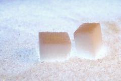 Backlit sugar. Two backlit refined sugar cubes Stock Images
