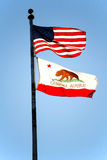Backlit United States And California Flags Blue Sky Royalty Free Stock Image