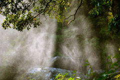 Backlit water spray from a waterfall Royalty Free Stock Photography