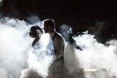 Bride and Groom in fog at night stock photos