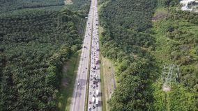 Aerial view of congested highway in 4K. Backlog highway moving towards a town during festive holiday season stock video
