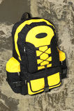 Backpack. A backpack isolated on rough texture background Royalty Free Stock Photography
