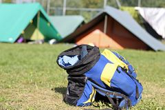 Backpack amid the tents of camp during the adventurous excursion Stock Images