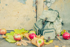 Backpack with apples on the threshold Royalty Free Stock Images
