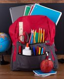Backpack With Assortment of School Supplies Stock Images