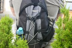 Backpack on the back of a tourist royalty free stock photography