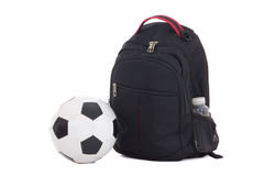 Backpack and ball isolated on white background Royalty Free Stock Image