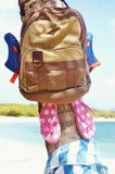 Backpack  beach sandals  palm tree seaside  adventure Stock Photography