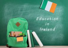 backpack, blackboard with text & x22;Education in Ireland& x22;, flag of the Ireland, books and notebooks stock images