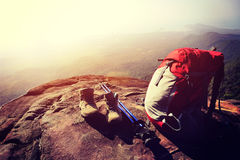 Backpack, boots and sticks on mountain peak cliff. Backpack, boots and sticks on sunset mountain peak cliff Stock Image