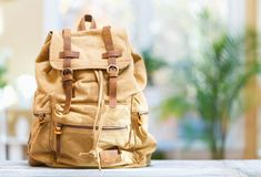 Backpack on a bright background stock photo