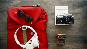 Backpack with camera and headphones Royalty Free Stock Photos