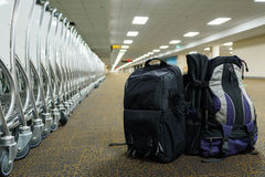 Backpack and cart with airport terminal background. Backpack  and cart with airport terminal background Stock Photos