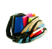 Backpack with colorful books and tablet PC. Against white background Royalty Free Stock Photography