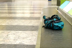 Backpack on conveyor. A backpack lies on the conveyor in arrival hall Stock Image