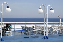 Backpack on the deck ferry. White ferry benches on Aegean Sea - Greece Stock Images